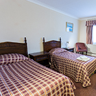 The Harrowgate Hill Lodge Twin Bedroom image